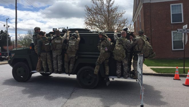 York County Quick Response Team members return from the scene of a police incident in Dover Township on the Bearcat armored vehicle on April 29, 2018. After an hours-long standoff, 46-year-old Eric Landis killed himself. No one else was harmed.