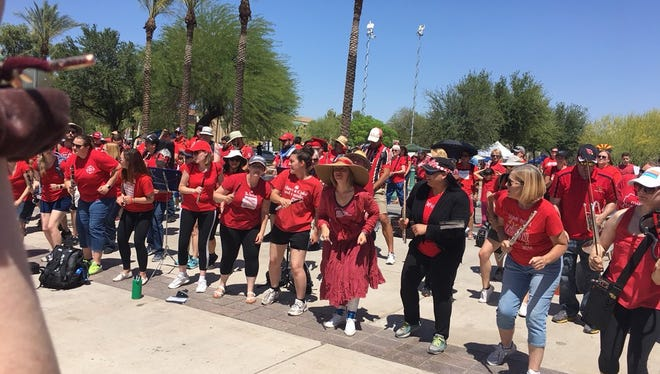 """Arizona Music Educators United end their performance with the send-off, """"Let's see you back in school"""" on Day 6 of the #RedForEd teacher walkout, May 3, 2018."""