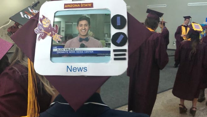 Wit his TV-set mortarboard design, Alex Valdez stood out amid the sea of maroon and gold at Arizona State University's recent commencement.