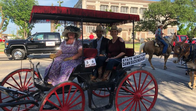 State Sen. Dawn Buckingham, right, Adrian Piloto, center, and driver Evadean Owen wait for the start of the Western Heritage Classic parade on Thursday in downtown Abilene.