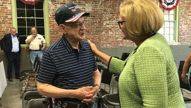 Sen. Claire McCaskill talks to Charles Cox during an event with local members of the group Veterans and Military Families for Claire to discuss veterans issues.