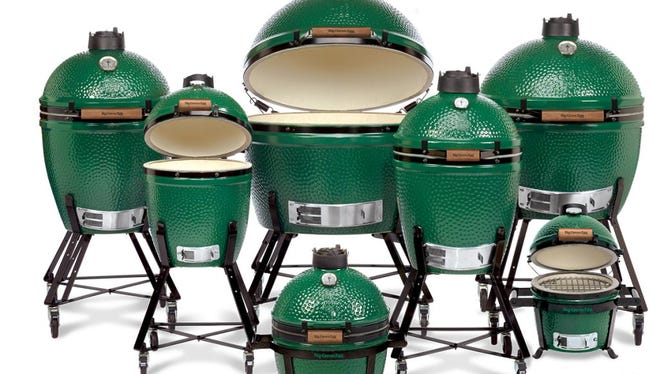 Big Green Eggs come in various sizes, nestled in nests. Tables and other accessories are available.