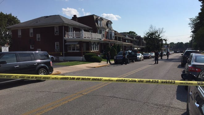 York City Police respond to a reported shooting near Penn Park Sunday.