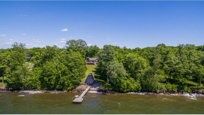 The level backyard walks down to 105 feet of Mille Lacs waterfront.