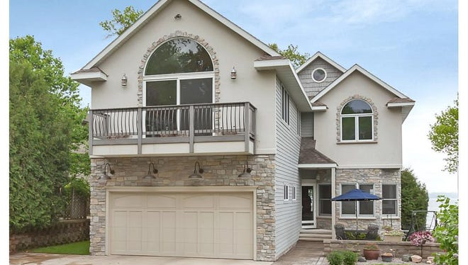 With multiple levels and living spaces, this property on Green Lake offers something for everyone.