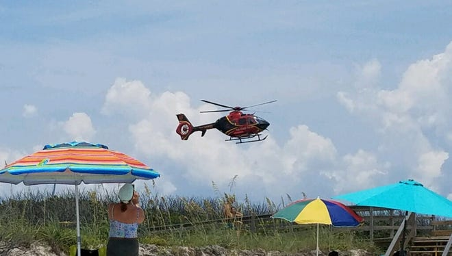 A teen was airlifted from Playalinda Beach Saturday after reportedly being bitten by a shark