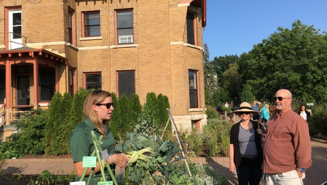 Allen Centennial Garden Director of Programs and Community Engagement Elin Meliska discusses the experimental vegetable varieties grown at the garden during a pre-dinner tour at last year's event.