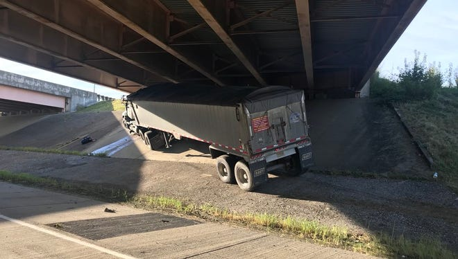 A semi stopped under the I-69 overpass on the Lloyd Expressway after a crash Thursday morning.