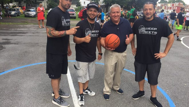 Sweep The Streets founders, from left, Robert Cleapor, George Rodriguez and Angel Cruz pose with State Senator Mike Folmer prior to the start of the 11th annual playground basketball event at Southeast Playground on Saturday.
