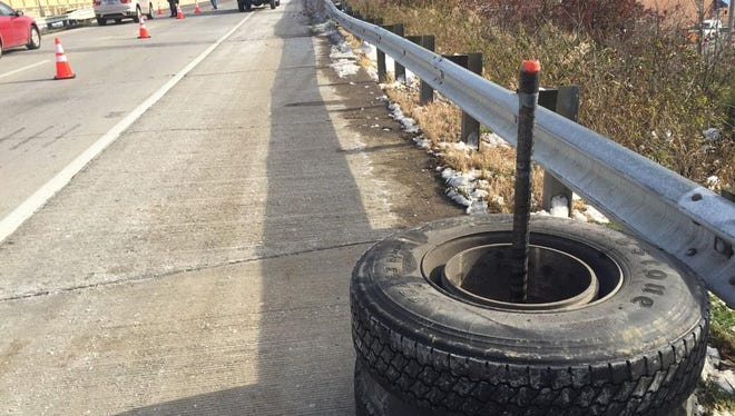 A semi's wheels snapped off of its axle on Ronald Reagan Wednesday and hit a car.
