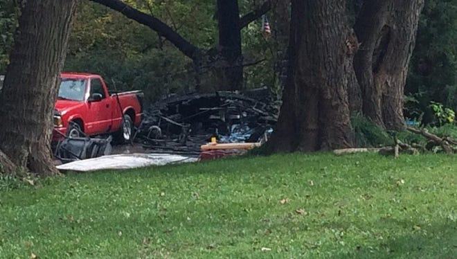 A two-car detached garage is a total loss from a fire in the 200 block of Pleasant View Drive in Des Moines on Friday.