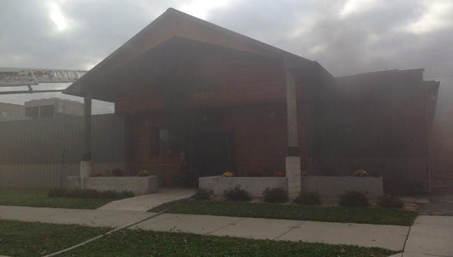 Smoke drift out of the Beech Grove Firearms in the 3000 block of S. Emerson on Thursday.