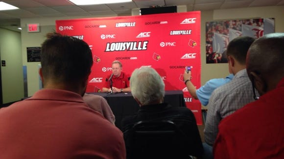U of L football coach Bobby Petrino answers questions