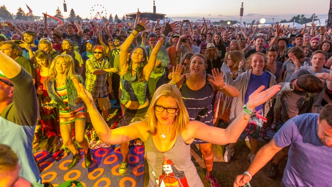 Phish fans welcome the band as they start their first set of the Friday evening at Magnaball, their three-day August festival  at Watkins Glen International racetrack.