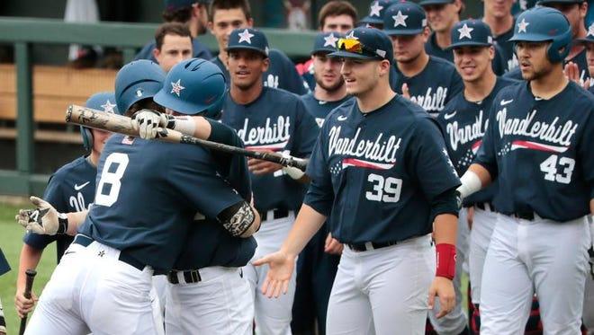 Vanderbilt's Rhett Wiseman (8) is congratulated after hitting a 2-run home run in the second inning of an NCAA regional baseball game Monday against Radford.