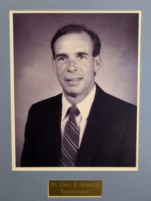 A photograph of former school superintendent Dr. Ed Sponseller, circa 1988, hangs in the board room at Chambersburg Area School District building on Thursday, April 6, 2017. Dr. Sponseller passed away Wednesday afternoon.