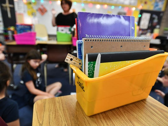 Students use materials from 'Teachers Pay Teachers' at St. Mary Catholic School in Royal Oak, Michigan on June 4, 2018.
