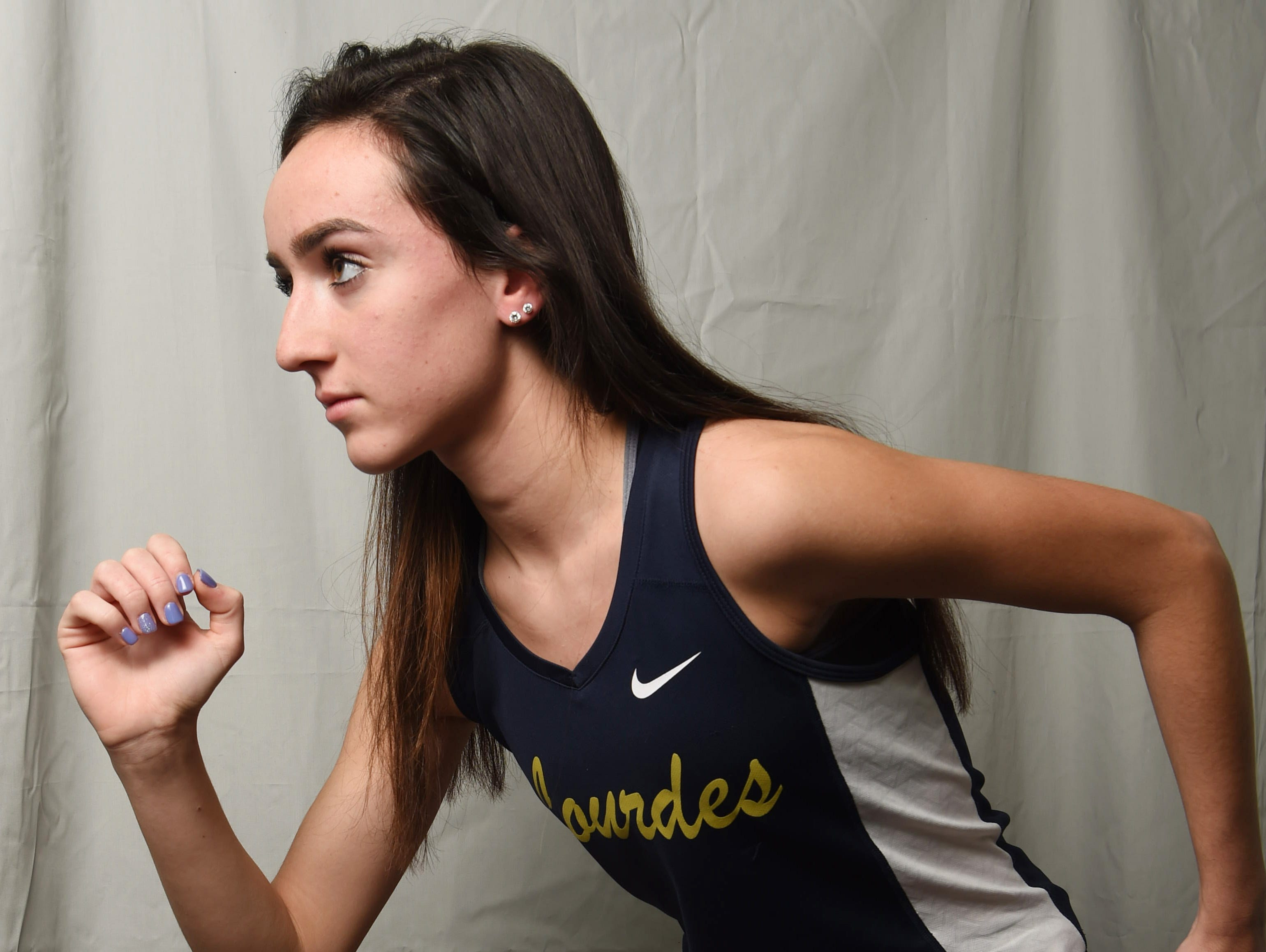 Caroline Timm from Our Lady of Lourdes High School is the Girls Runner of the Year.