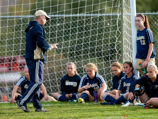 Essex head coach Bill O'Neil talks to his team during halftime during the girls soccer game between the Essex Hornets and the Champlain Valley Union Redhawks at CVU High School on Tuesday afternoon October 15, 2013 in Hinesburg, Vermont.