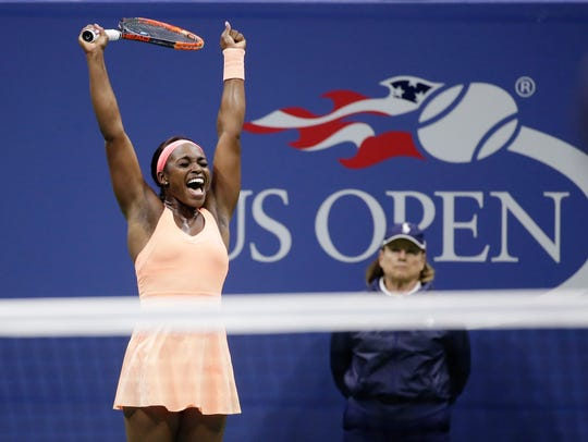 Sloane Stephens reacts after defeating Venus Williams