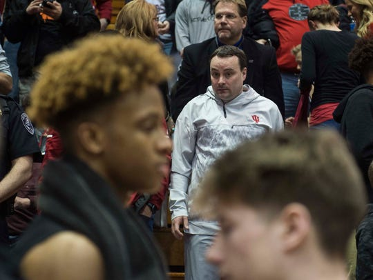 Indiana University head coach Archie Miller, middle,