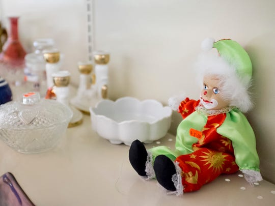 A dolls sits among other items on a shelf Tuesday, September 20, 2016 at Bargain Barn in Port Huron. The business will close this Saturday after five years.