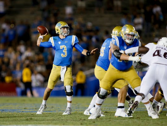 UCLA quarterback Josh Rosen throws a pass during this