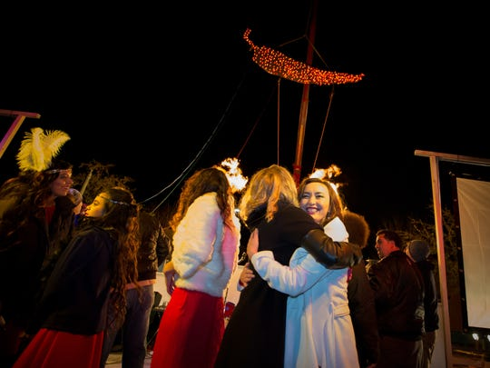 People celebrate the new year on Thursday night's Child Drop party on Main Street.
