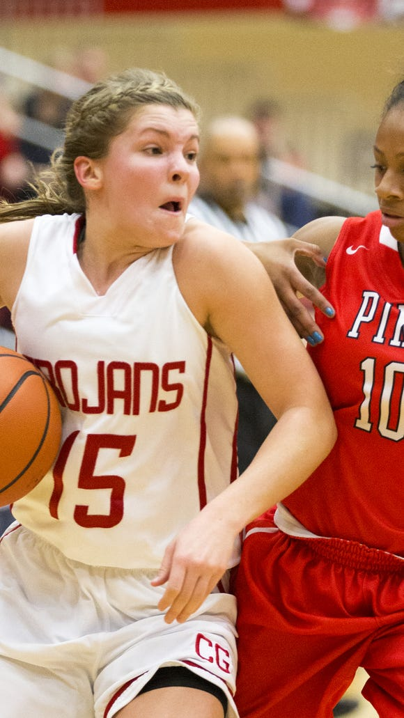 Lauren Rau (left), of Center Grove High School, works a possession against Pike High School's LaRae Rascoe, during the Pike defeat of Center Grove High School, 74-66, girls basketball from Center Grove, Greenwood, Saturday, Dec. 20, 2014.