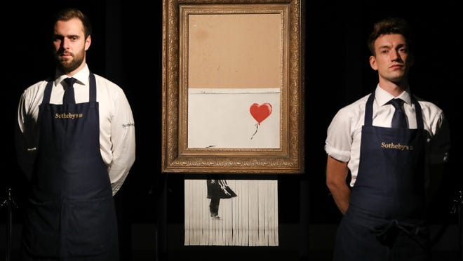 Sothebys unveils Banksys newly-titled Love is in the Bin at Sotheby's on October 12, 2018 in London, England. Originally titled Girl with Balloon, the canvas passed through a hidden shredder seconds after the hammer fell at Sothebys London Contemporary Art Evening Sale on October 5, 2018, making it the first artwork in history to have been created live during an auction.