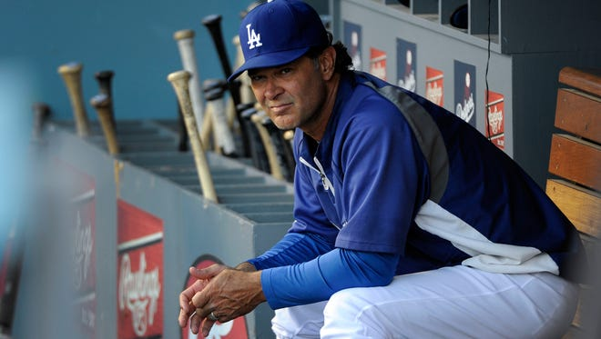 Dodgers manager Don Mattingly in the dugout before his team's game against the Atlanta Braves at Dodger Stadium.