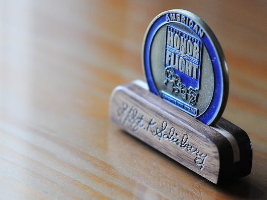 Ken Salisbury made wood coin holders for each of the Honor Flight veterans to hold the memento they were given for the trip.