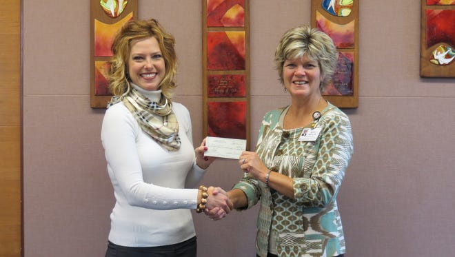 The Ladies Association of Port Huron Golf Club Pink Ribbon Tournament on July 23 was a success in raising breast cancer awareness. Presenting a check for almost $2,500 raised at the event to Rebekah Smith, president and chief executive officer of St. Joseph Mercy Port Huron, is Marnie Rossow, chairwoman of the Ladies Golf League Fundraiser. The Mercy Pink Ribbon Fund supports women who need advanced breast cancer diagnoses but do not have the resources to pay for their care.