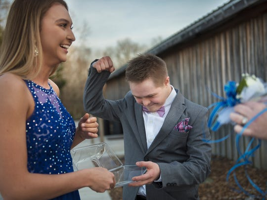 "Allen Patterson, of Beech Bluff, pumps his fist in the air as he hands a corsage to his prom date, Lily Cottrell, on Thursday, March 22, 2018, before the Union EDGE Program's annual special needs prom, ""The Royal Ball,"" at The Barn at Snider Farms in Denmark."