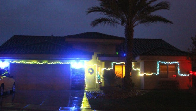 Some houses in Mesquite use blue lights during the holiday season to support fallen police officers.