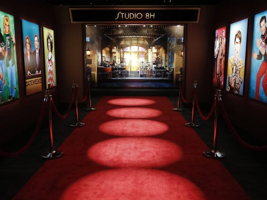 """A red carpet leads to Studio 8H at the """"Saturday Night Live: The Exhibition,"""" in New York. Located on Manhattan's Fifth Avenue, the exhibition steers visitors step by step, room to room, through the process of putting together each show in just six days."""