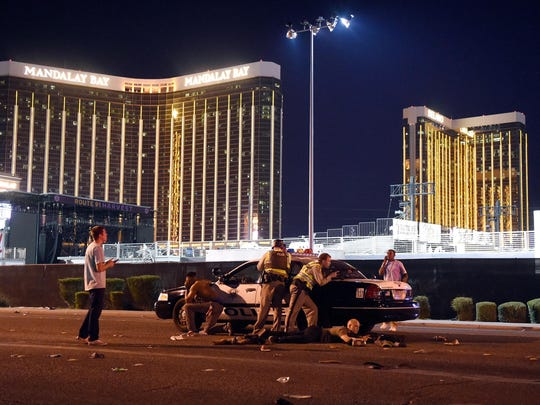 Las Vegas police stand guard along the streets outside the Route 91 Harvest Country music festival grounds of the Route 91 Harvest on Oct. 1, 2017 in Las Vegas, Nevada.