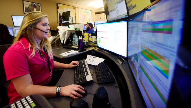 Dispatcher Kira Stammer monitors calls from her work station at Metro Communications inside the Minnehaha County Jail. Metro Communications is adding two power shifts to its daily schedule to help with peak call volume times.
