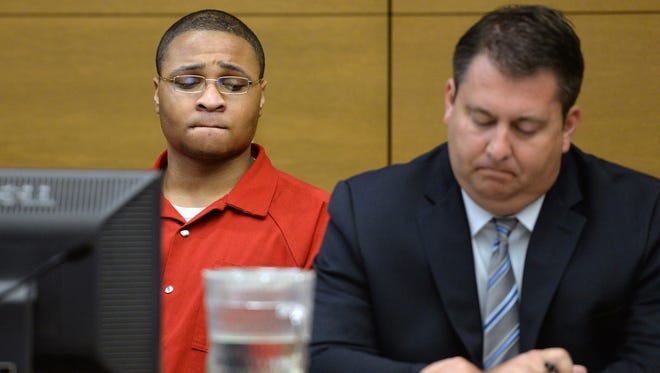 Defendant Dexter Lewis, left, sits with his defense attorney Christopher Baumann, right, during his sentencing hearing Sept. 30, 2015, in Denver District Court.