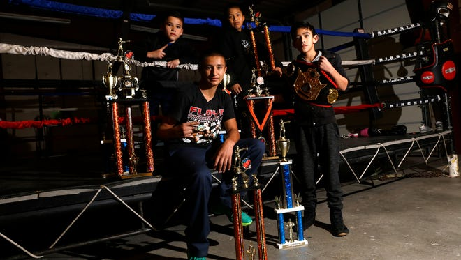 Clockwise from top left: Jaime Sanchez, Amery Williams, Aljendro Sanchez and Elijah Martinez pose for a portrait on Wednesday at the 505 Fight Factory in Farmington.