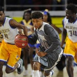 Fulton's Dashaun McKinney (40), runs up the court during a Class AA state semifinal game at Middle Tennessee State University on Friday March 18, 2016. Fulton defeated Fayette-Ware 75-66.