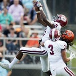 Oak Ridge's Tee Higgins intercepts a pass intended for Clinton's Demarea Whitt at Clinton on Thursday, August 18, 2016. Also defending on the play is Mark Kaczocha. (SAUL YOUNG/NEWS SENTINEL)