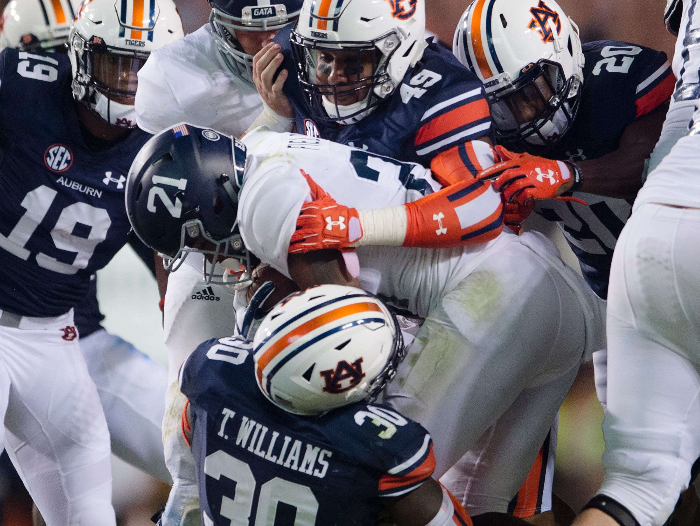 Auburn linebacker Tre' Williams (30) and Auburn linebacker Darrell Williams (49) tackles Georgia Southern running back Wesley Fields (21) during the NCAA football game between Auburn vs. Georgia Southern on Saturday, Sept. 2, 2017, at Jordan Hare Stadium in Auburn, Ala.