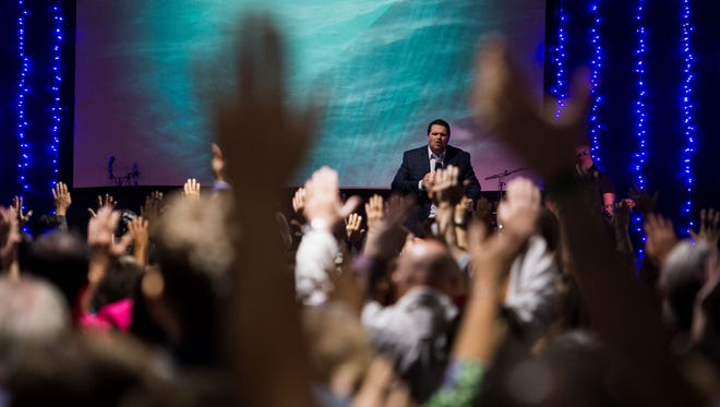 Oceans Unite Christian Centre Pastor Alex Pappas leads an opening celebration service at the Indian River Mall on Sunday, Feb. 18, 2018, in Vero Beach.
