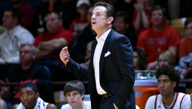 University of Louisville head coach Rick Pitino, shown during a game last month, was criticized by some fans over the school's self-imposed sanctions.
