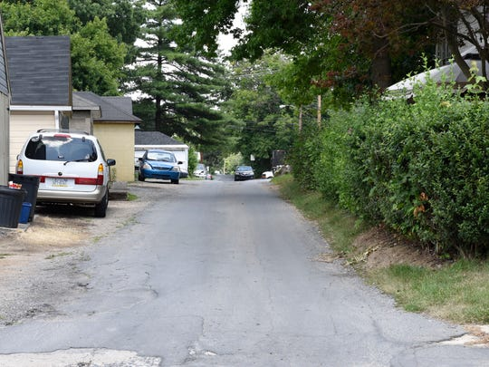The area of Columbia Court looking north from Ramsey Ave. is seen Wednesday, July 13, 2016. The alley, often used as a short cut between Norland and Ramsey avenues, will soon become one-way.