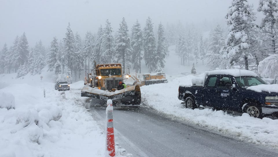 Crews work to clear part of Mt. Rose Highway on the