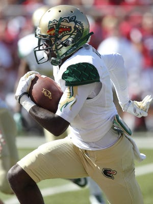 UAB Blazers kick returner J.J. Nelson (1) returns a kick for a touchdown against the Arkansas Razorbacks during the third quarter at Donald W. Reynolds Razorback Stadium. Arkansas defeated UAB 45-17. Mandatory Credit: Nelson Chenault-USA TODAY Sports