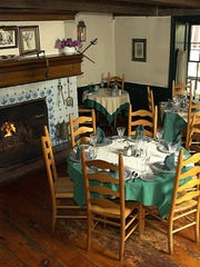 The dining room at the Old '76 House in Tappan, complete with a fireplace, is a great spot to enjoy a cozy winter meal out.