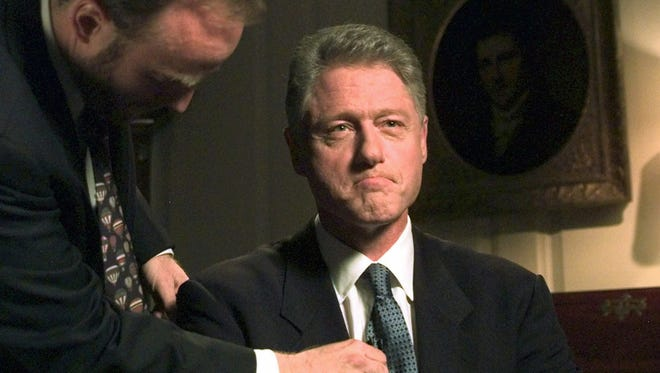 "President Clinton sits in the Map Room of the White House in Washington, Monday, August 17, 1998, before making a statement to the American people about his relationship with former intern Monica Lewinsky. Clinton acknowledged to a grand jury and the nation that his relationship with Lewinsky was ""not appropriate."""